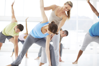 A yoga instructor instructing a yoga class